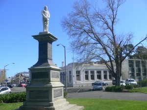 Statue of Te Keepa Te Rangihiwinui at Moutoa Gardens, Whanganui. Behind is the old Native Land Court Building, one of the last still standing in NZ.