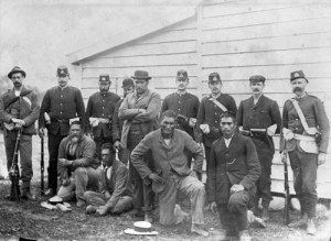 Hone Toia of Rawene (standing, centre) with supporters apprehended in 1899. Source: NZHistory.net.co.nz