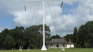 The flag pole, and Treaty House, at Waitangi. The Union Jack flag was raised here on 6 February, 1840.