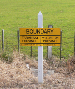 A relic of yesterday - signpost denoting boundary (abolished 1876) between Provincial Governments of Wellington and Taranaki. Signpost is just south of Patea.