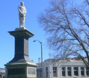 Statue of Major Te Rangihiwinui Kepa, Moutoa Gardens/Pakaitore, Whanganui. Old Native Land Court Building stands across the road.