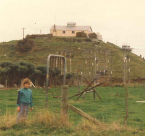 Lauren standing beneath the Parihaka Stockade, photo taken about 1988. Te Whiti and Tohu were held in this stockade, after their arrest, on their way to trial in New Plymouth.