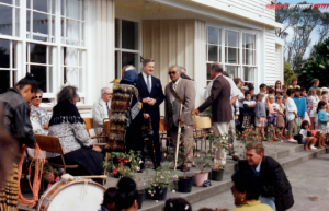The Pungarehu School Centenary 1992 - new Prime Minister Jim Bolger chats with Te Ru Koriri Wharehoka, kaumātua of Parihaka. Far left (sitting) is Te Miringa Hohaia, alongside Aunty Poppy Bailey.